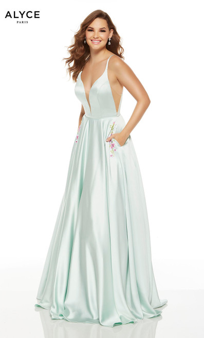Sea Glass formal gown with floral embroidery at pockets and a plunging neckline