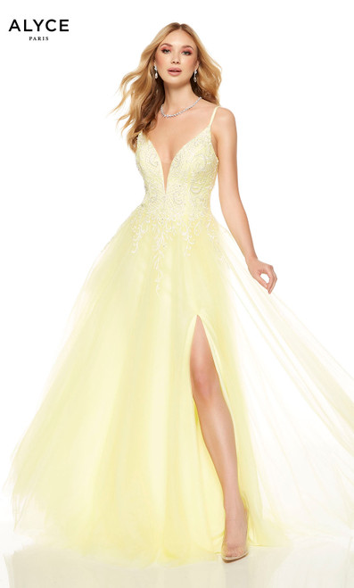 Flowy Lemon Drop prom dress with a plunging neckline and a front slit