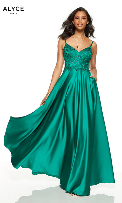 Emerald formal dress with a v-neckline and pockets