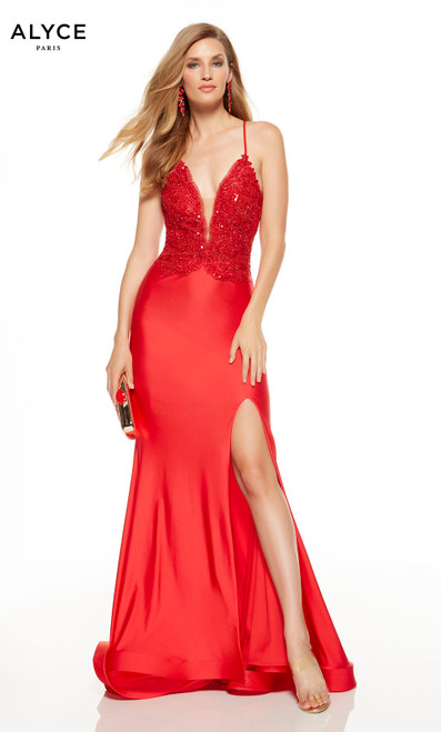 Red formal dress with a plunging neckline and a slit