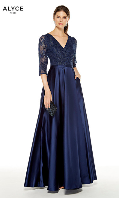 Navy mother of the bride dress with a V-neckline and pockets