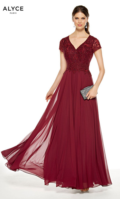 Burgundy flowy wedding guest dress with a V-neck and short sleeves