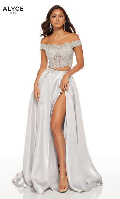 Silver two piece prom dress with an off the shoulder lace crop top and a high slit