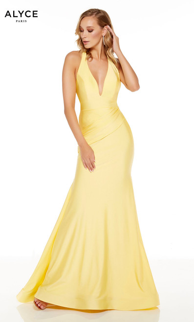 Yellow mermaid style prom dress with a plunging neckline