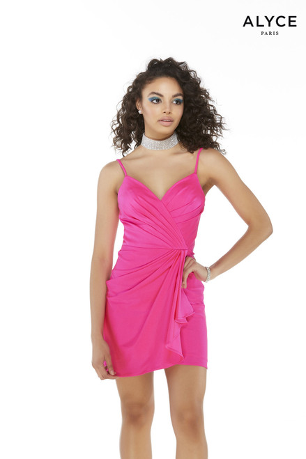 Fuchsia colored short semi formal dress with a v neckline, ruched bodice, and draped skirt