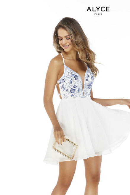 Short white graduation dress with a plunging neckline and blue floral embroidery on the top
