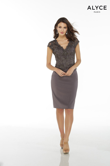 Gunmetal jersey knee length cocktail dress with a V-neck, cap sleeves, and a lace peplum top