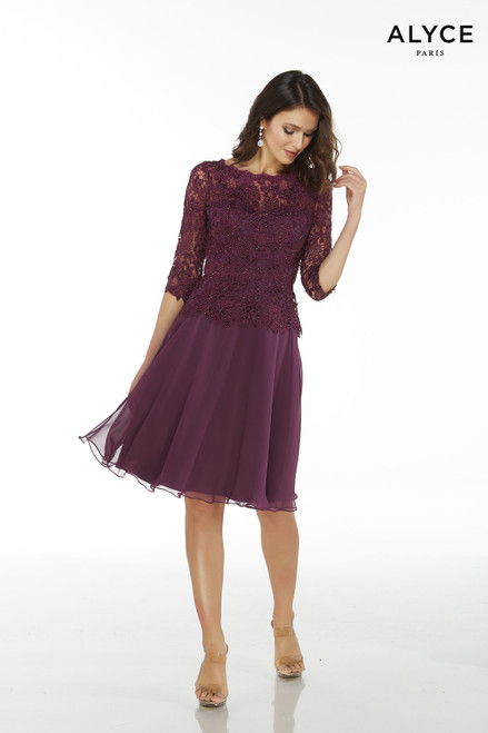Aubergine colored flowy chiffon knee length cocktail dress for weddings with a lace peplum top and 3/4 sleeves