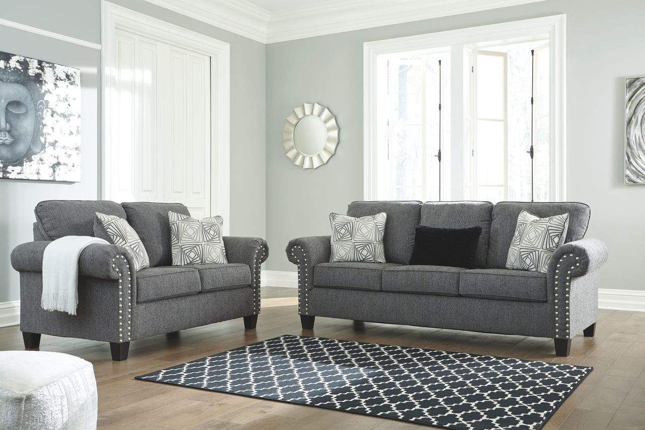The Agleno Charcoal Sofa & Loveseat available at Furniture Plus