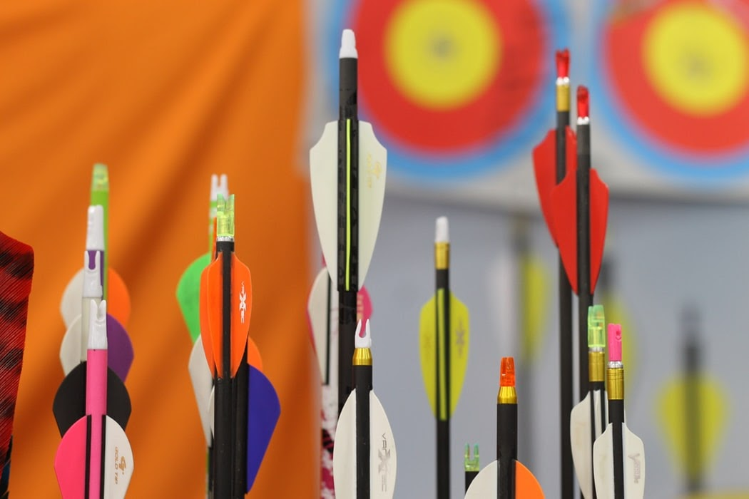 colorful arrows in front of archery target