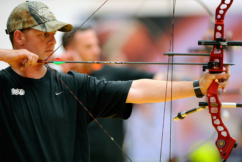 army vet shooting bow with archery sponsorship