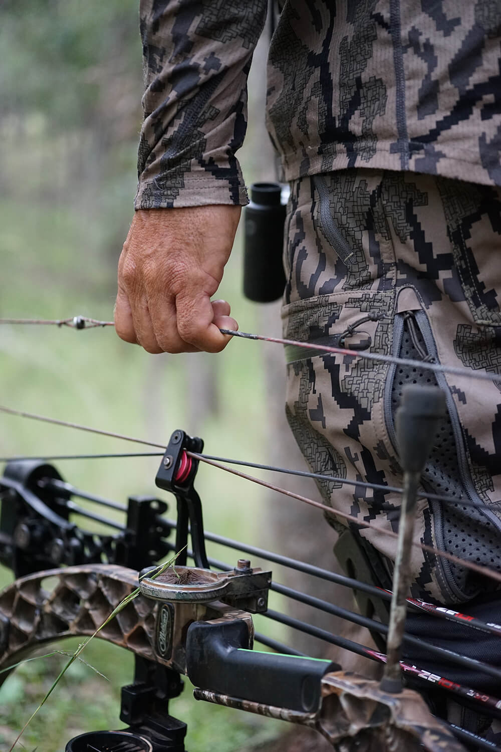 bow hunter holding custom bow string