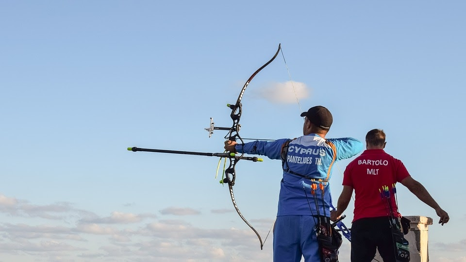 competition archer shooting a recurve bow