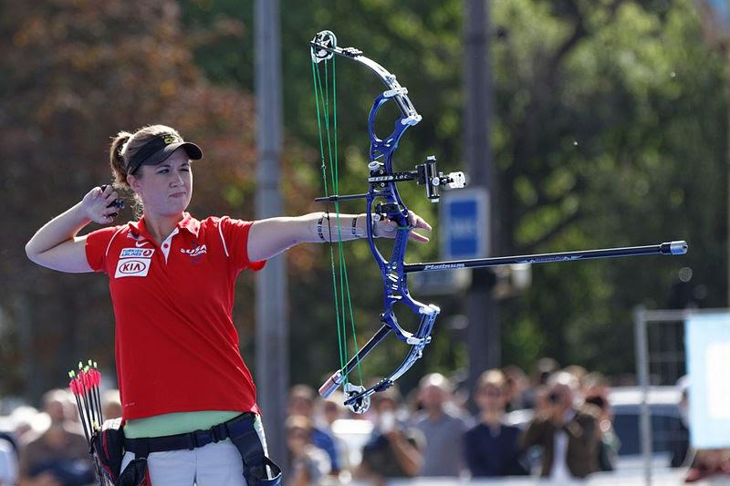 competitor using stabilizer part of a bow