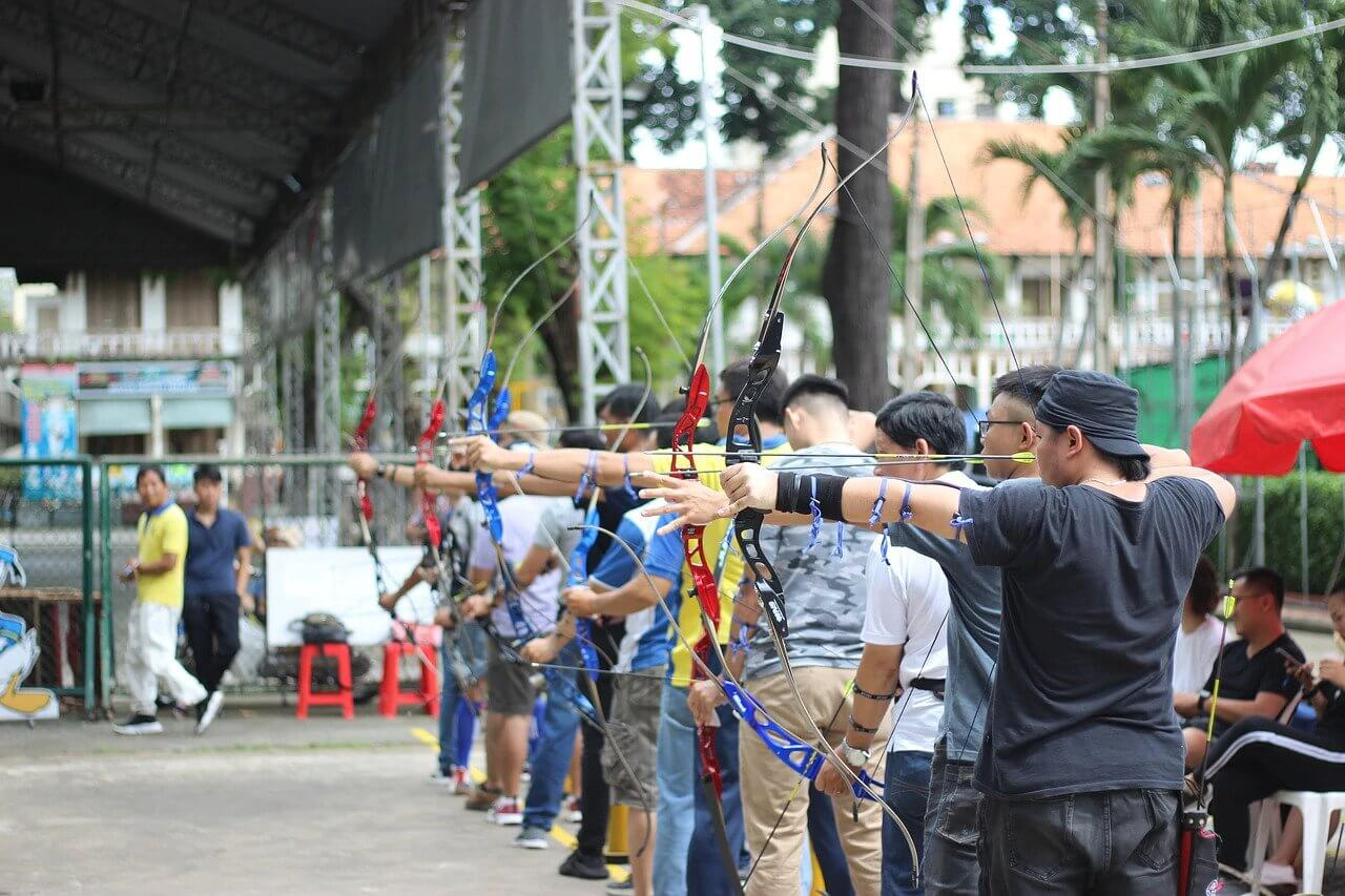 men lined up competition archery sponsorship