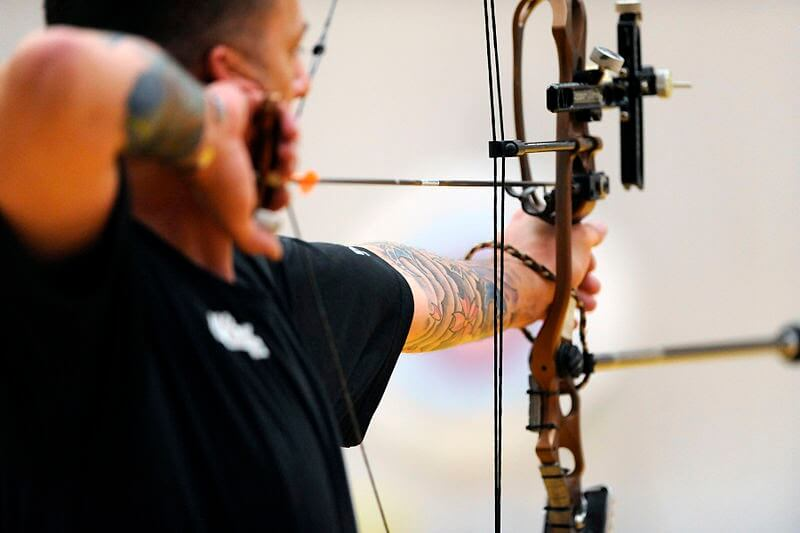 professional archer using peep sight