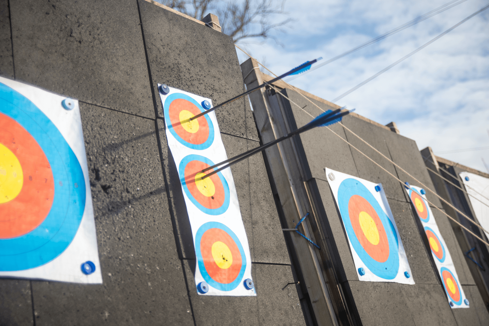 three arrows in small vertical outdoor archery targets