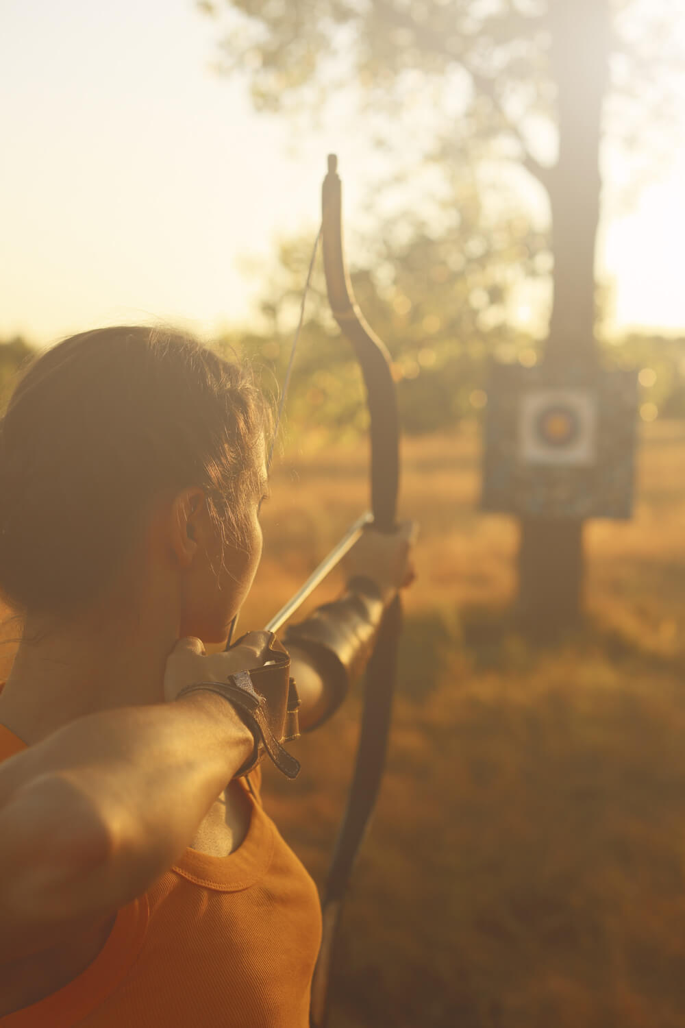 woman practicing recurve bow shots