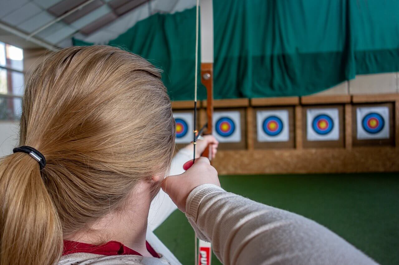 woman shooting archery sponsorship targets