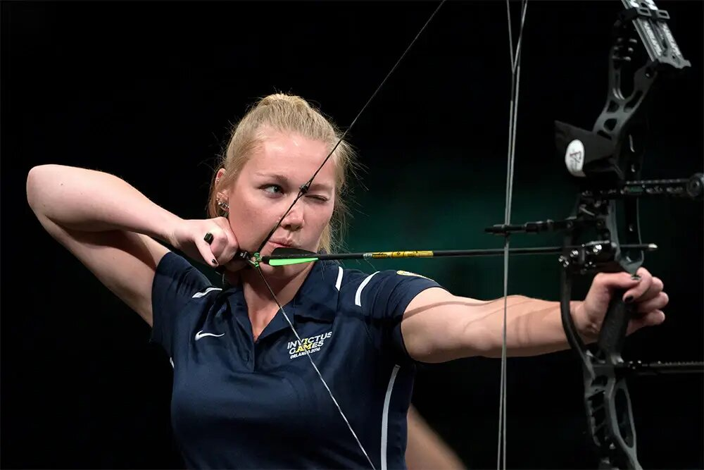 woman with archery sponsorship shooting bow