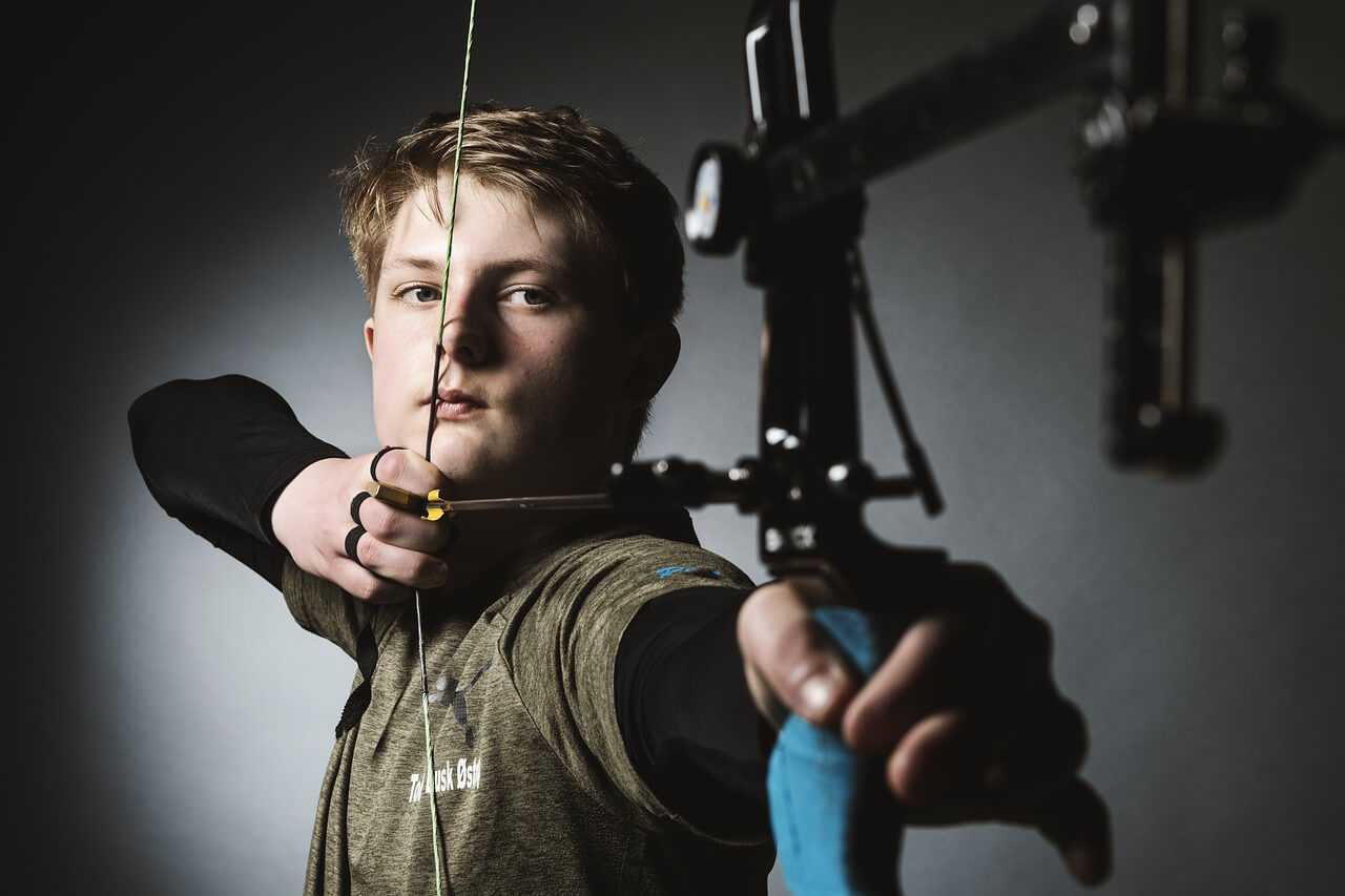 young boy shooting bow archery sponsorship