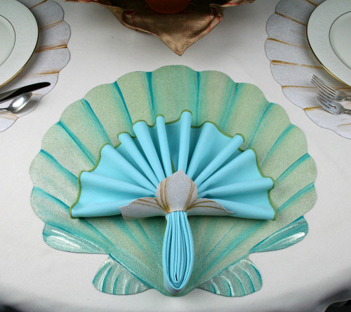 Hand-painted Scallop Shell Placemat in Seafoam with Aqua highlights. Click here to order, on sale now. Reg. 15.00, sale 10.00