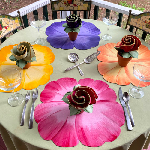 Pansy Table is four hand-painted and poly-coated pansy placemats in pink, yellow, orange and lilac, with color-coordinated Bouquet Napkins made possible by Carole's hand-painted Leafy Green Napkin Rings!