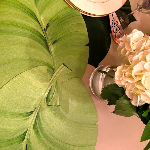 Two beautiful palm leaves interlock to create a calming centerpiece or runner, as shown.