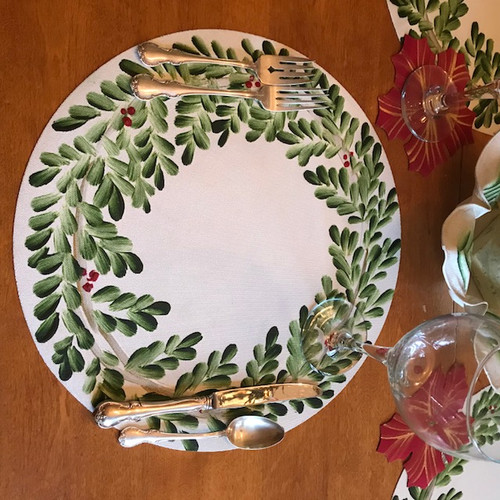 Simply elegant, Carole's Hand-Painted Wreath Round Placemat is now a Christmas Classic. Made in Kingston, New York. Simply sponge clean after each festive use.