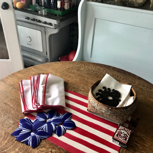 Four napkins + four rings + one hand-painted red & white striped rectangular placemat = One Classic Americana Centerpiece!