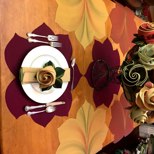 Stunning Set of 6 Placemats fall to the table in so many ways. Here, with Burgundy/Gold both at the helm and center, surrounded by 2 Gold/Copper and 2 Copper/Gold.  Coordinate with Bouquet Napkins, shown here in assorted colors gathered in the center, and sitting atop the plate, for added beauty that's also easy-care!