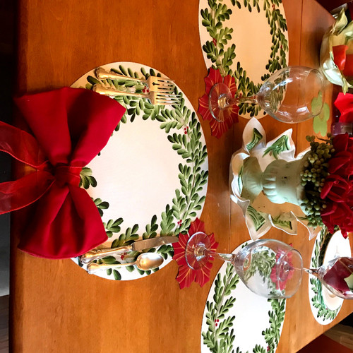 "Set includes one 15"" round hand-painted Wreath Placemat, and one rich (easy-care) 20"" Red Napkin bow-tied with a red ribbon!"