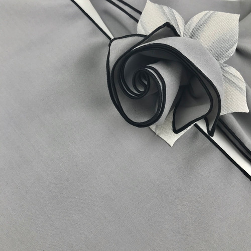 Silver/black napkin, the new neutral, shown here with the white/silver napkin ring; looks good with so many other colors as well.