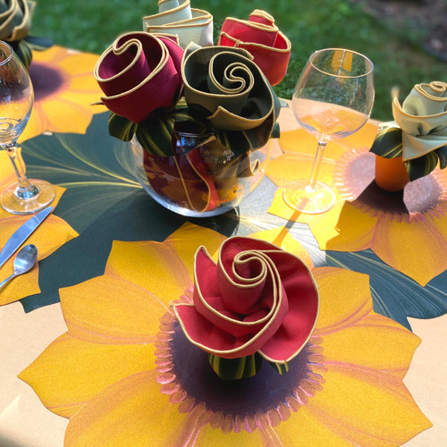 Four golden sunflower placemats and four napkins and rings. For a different napkin color choices than shown (or all one color, such as the orange/gold as shown front, specify in ship notes or call please: 845.339-4646.
