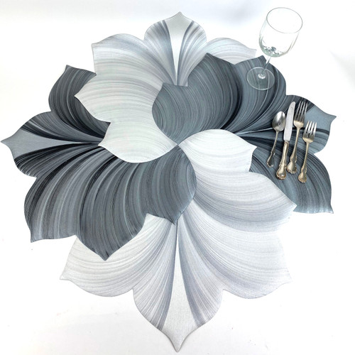 Purchase two grey/black leaf placemats and interlock to create a runner; two more, in the same colorways or in  white/silver as shown, will further interlock into a harmonious centerpiece!
