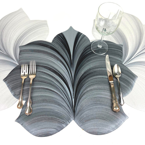 Grey/black Interlocking Leaf Placemat sets an individual place setting like an outstretched hand.