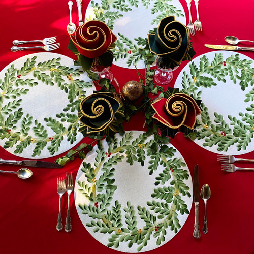 4 hand-painted wreath placemats with red and green napkins and hollyberry napkin rings, as shown.