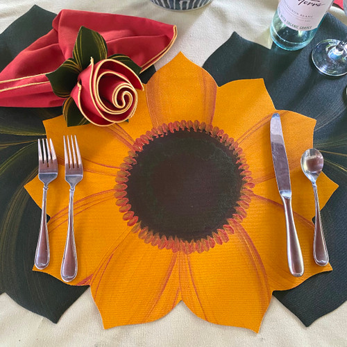 Golden Sunflower Setting includes the hand-painted Placemat with Burnt Orange/Gold trim Napkin and Leafy Napkin Ring-to-Coaster in Pine/Gold. Made in USA on repurposed fabric. To add the two leaves that frame this setting, go to Interlocking Leaves in Pine/Gold by clicking here: https://www.caroleshiber.com/7-point-leaf-pine-gold-bronze/