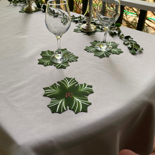 Choosing the right tablecloth will set the tone for the most beautiful tablescapes. Here, silver/grey spreads out an elegant ground on which to layer your most lovelies.