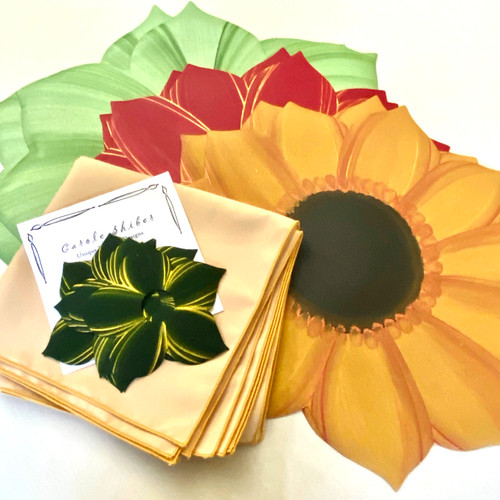 Set of 6 assorted placemats come with 4 coordinating napkins and rings-to-coasters will take you gracefully with place-settings for four from season-to-season by changing out sunflowers for poinsettias.