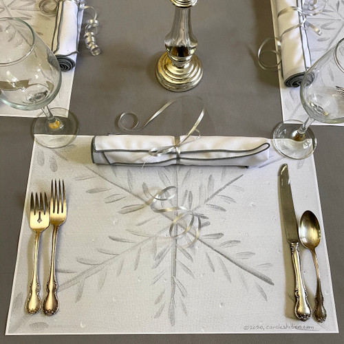 "Setting includes 11x17"" cardstock paper placemat, 20x20"" white/silver edged napkin and ribbon to use as napkin tie.  Click here for our easy-care, no-iron Silver grey tablecloth, as shown below placemat: https://www.caroleshiber.com/the-silver-grey-tablecloth/"