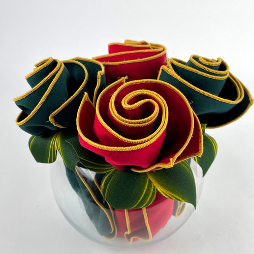 Poinsettia Red and Forest Napkins edged in gold with pine/gold Napkin Rings