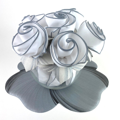 Set of 6 winter white/silver napkin bouquet. (Add silver/black buttercup placemat for foundation as shown here.)