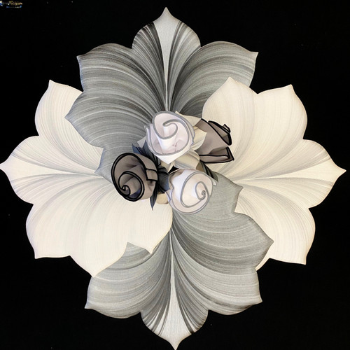 The grey and white complete set for 4 is this: 2 + 2 = 4 beautifully paired placemats with 4 napkins and 4 napkins = 1 outstanding centerpiece with everlasting rose bloom napkin bouquet.  All pieces are easy-care. A perfect gift for someone who entertains, or simply loves to decorate.
