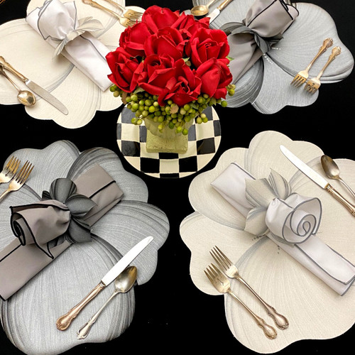 "2 Grey/black and 2 white/grey buttercup placemats sit around the table in an almost ""puzzling way"".  Perfectly complemented by their coordinating napkins and rings in grey/black, and white/grey. Add your own touches of color (they all go!) or remain in neutral, and enjoy the calm."