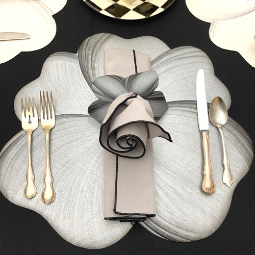 Complete setting: silvery grey/black buttercup placemat sits so handsomely pretty with its grey/black rose bloom napkin & napkin-ring-to-coaster.