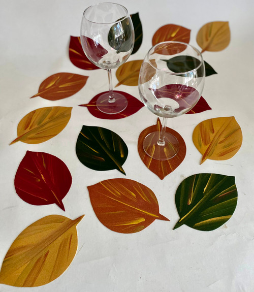 Set of 4 assorted: gold, copper, pine/gold and burgundy, shown here as more than a dozen. Scatter anywhere you want to add a little art.