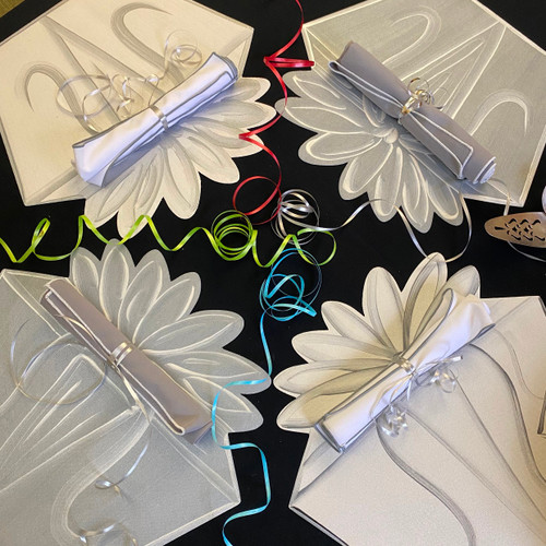 4 assorted grey/white and white/grey place-settings include placemats and napkins.