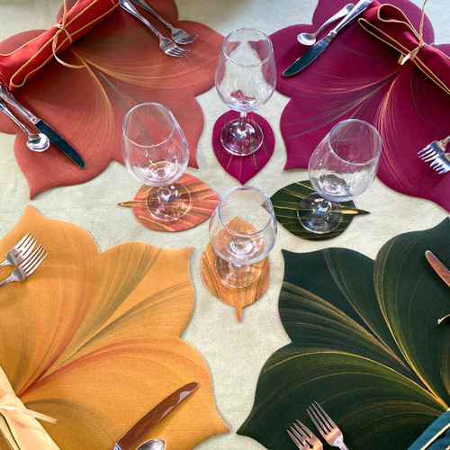 Gold, Copper, Burgundy and Pine grace this collection of 4 Maple Leaf Placemats and Aspen Leaf Coasters.