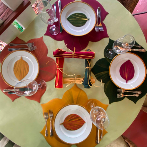 Complete set includes 4 placemats, 4 coasters and 4 rolled gold-trimmed napkins.